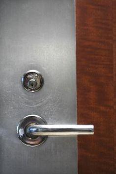 How to Fill Holes in a Metal Door thumbnail Steel Doors, Wood Doors, Door Knobs, Door Handles, Painting Metal Doors, Wood Handrail, Stainless Steel Refrigerator, Making Life Easier, Open Concept Kitchen