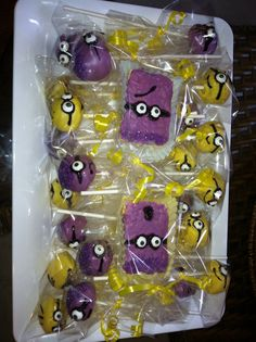 Chocolate covered minion cake pops & rice crispy treats.