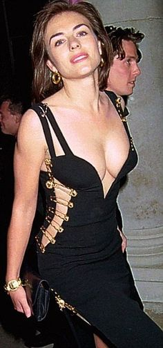 """Elizabeth Hurley wore a black Versace dress, often referred to as """"That Dress"""", when she accompanied Hugh Grant to the premiere of Four Weddings and a Funeral in Elizabeth Hurley Bikini, Elizabeth Hurley Bedazzled, Elizabeth Jane, Iconic Dresses, Versace Dress, Elisabeth, Red Carpet Dresses, Beautiful Actresses, Lady"""