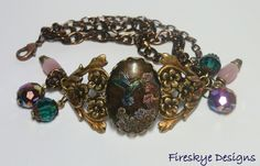 Hummingbird cameo bracelet - American made brass - hand painted - pink moon glow beads - cuff - brown - green - purple - iridescent by FireskyeDesigns on Etsy