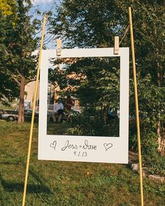 Simply cute #polariod #frame at this #outdoorwedding #booth!: #BuzzFeed #ShannonCollinsPhotography