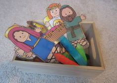 Laminated nativity characters on Popsicle sticks. Great for children to handle and play with. Easy to make.
