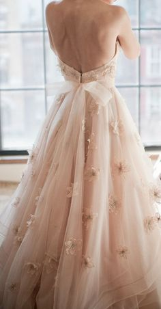 Blush wedding dress with beautiful flowers. If you want the best officiant for your Outer Banks, NC, ceremony, contact Rev. Barbara Mulford: myobxofficiant.com/