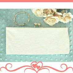 """HP Structured clutch. FIXED PRICE. A simple but elegant clutch in beige/ winter white. One extra small compartment for cc. Gold hardware. Gold shoulder strap. Faux patent, very crinkled, ribbed texture.  Details: L11-3/4"""" H4-3/4"""" W1-1/2"""". The color in the third picture is the most accurate, it's more winter white. Shoe Dazzle Bags Clutches & Wristlets"""