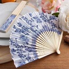 Our vintage french country design silk fans have a charming cobalt blue toile rose pattern perfect for event fans for your rustic, vintage or