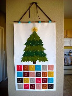 My family used to have an advent calendar JUST like this!  My great-aunt made it.  Unfortunately it has been lost to us.  I would dearly like to make one to replace it but I feel like I don't have the sewing skills.