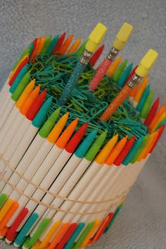 """Make a back to school """"cake"""" using school supplies. Check out http://www.parenting.com/article/back-school-bash?page=0,1 for another variation using No. 2 Pencils. Fun gift for a teacher or student going back to school."""
