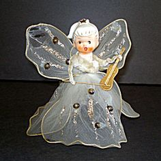 Christmas Wired Tulle Ponytail Angel Figurine Porcelain Head. Click on the image for more information.