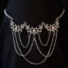 Stainless steel and brass filigree necklace with chains and swarovski crystals. The filigree part of the necklace measures 8.5 cm wide and is 6.5cm long. Make sure to measure your neck to get the correct size. If you need a size not listed, please specify at the checkout.