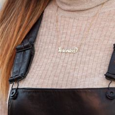 custom gold necklace, leather overalls, and a blush turtleneck... We're in love