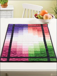"Use precut jelly-roll strips to make this colorful table runner. This e-pattern originated in Quilter's World August 2008.    Size: 33 1/2"" x 17 1/2""."