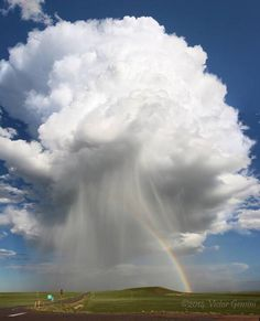 Breathtaking rainbow and thunderstorm photographed in Colorado is part of Clouds - The photo beautifully shows off the rolling terrain, the mushroom head of the billowing cumulus cloud, its vigorous rain shaft, and of course the vibrant rainbow All Nature, Science And Nature, Amazing Nature, Tornados, Thunderstorms, Storm Clouds, Sky And Clouds, Wild Weather, Natural Phenomena