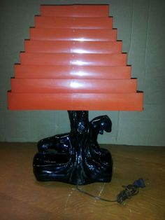 Mid-century modern black panther tv lamp with stand - lane & co