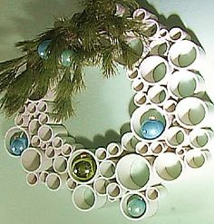 Holiday Wreath from different size PVC pipe. hmmm- thinking something similar with TP rolls