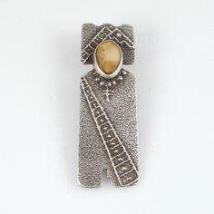 "Silver ""Generation Spirit"" Tufa Cast Pendant with Fossilized Ivory  by Joel Pajarito, Santo Domingo"
