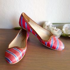 """HP BROOKS BROTHERS Silk Tie Striped Ballet Flats BROOKS BROTHERS coral, blue and white Silk Tie Striped Ballet Flat is crafted in silk twill with a calfskin trim. Fully leather lined and padded sock with a leather sole. ¼"""" heel. Imported. Heals have wear, but lots of life left. Uppers are in great condition, but left side has small mark on inside, and some normal wear. True to size. Sorry no box or dust bag Brooks Brothers Shoes Flats & Loafers"""