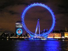 London Eye  London Eye in one such an iconic wheel which can be seen from far and with ornamental lightings it becomes angel every night. This is a giant wheel structured beside the river Thames. Traveller can have a ride in this giant wheels and the view of London City from top is amazing. It always looks good in night.        Keywords:      London      London Eye      Night
