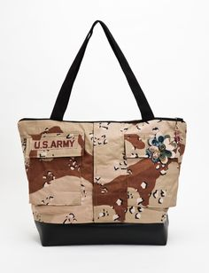 A nice big camo custom handbag by www.militaryapparelcompany.com/jodyb specializing in custom handbags, purses and accessories crafted from personal military uniforms. We also offer Military Blankets and awesome Military gifts for the entire family! www.facebook.com/jodyformilitaryapparelcompany