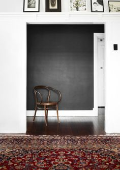 Charcoal gray walls, wood floor, antique rug.      nicolecfranzen:    Photography by Toby Scott