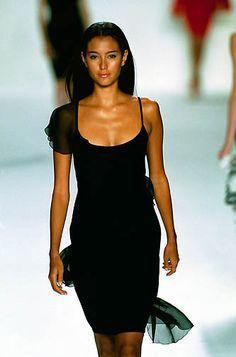 Bill Blass | Spring 2000 Ready-to-Wear | 101 Black asymmetrical shoulder mini dress