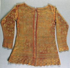 """""""Women's camiciola or knitted jacket, first quarter of seventeenth century, Florence, Museo Stibbert.    Camiciola knitted in red and gold silk, made by male professionals. This type of garment, already present in Eleonora's wardrobe, is recorded with increasing frequency in the documents of the second half of the century.""""    © Moda a Firenze 1540 - 1580, Roberta Orsi Landini and Bruna Niccoli, Edizioni Polistampa, Florence, 2005"""