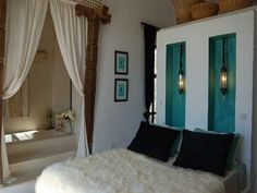 Gorgeous Marrakech villa bed room.  No sheepskin for me, if that's what I see.