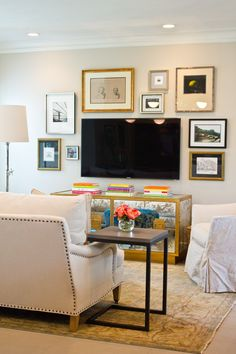 Roll arm sofa nailhead detail, gallery wall composition around TV | Lauren Haskett Houston Interior Design