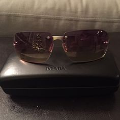 Prada Candy Lens Ombré Sunglasses Authentic Prada candy lens frameless sunglasses. The lenses shade from light purple to yellow. The arms are smoked grey plastic. No visible scratches, good used condition. Prada Accessories Sunglasses