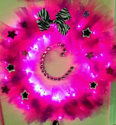 Pink Diva lighted tulle wreath by TheBeesKneesWreaths on Etsy, $55.00