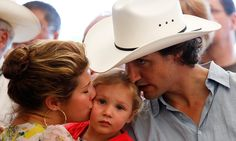 It's an Ella-Grace sandwich! The couple's second child is treated to a double dose of kisses during the Liberal Stampede breakfast marking the anniversary of the Calgary Stampede in the summer of Photo: Todd Korol/Reuters British English, American English, Trudeau Canada, Justin Time, Premier Ministre, Leadership Roles, Imran Khan, Justin Trudeau, Great Leaders