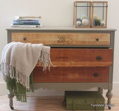 grey base with natural drawers.