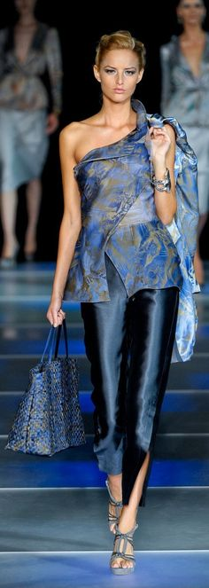 Giorgio Armani | could have under wrapped layer come up to form left sleeve for more coverage.