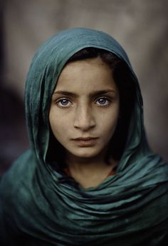 Steve Mccurry Studios. This young child and her parents had fled the civil war in Afghanistan and were living in Pakistan.