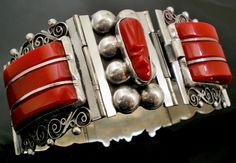 Red Mexican Deco Bracelet. c. 1930's or early 1940's.  | This bracelet is the result of the renaissance that emanated from Taxco & flourished from the 1920's-60's in several cities throughout Mexico. Beginning in the 1920's, the silver artisans of Mexico rose to a new definition of perfection in design and craftsmanship as the result of the strong influence & patronage of William Spratling, a talented architect & designer who engendered a city of tallers and jewelers in Taxco during that…