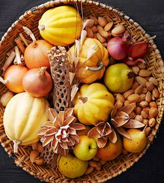 Fill a basket full of natural fall elements. Think outside of the box and include nuts, dried flowers, gourds and drift wood.