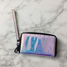 TOPSHOP hollographic wallet Bought on posh and never used it Topshop Bags Clutches & Wristlets