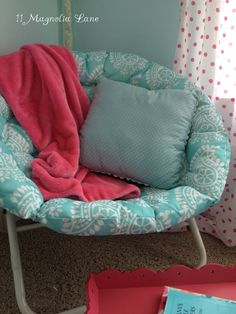 Reading corner with papasan chair in aqua and white