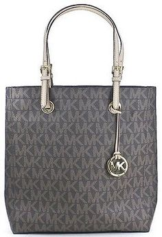 Michael Kors Jet Set Mk Monogram Brown Faux Leather Ns Travel Tote. Get one of the hottest styles of the season! The Michael Kors Jet Set Mk Monogram Brown Faux Leather Ns Travel Tote is a top 10 member favorite on Tradesy. Save on yours before they're sold out!
