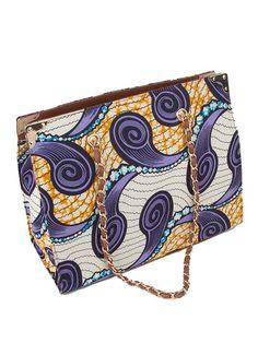 Beautiful african wax print handbag - blue yellow purple: http://www.africanpremier.com/african-fabric-design-handbag-for-women-with-leather-interior-bag003-1.html