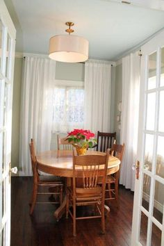 like the light fixture... drapes over shutters maybe??
