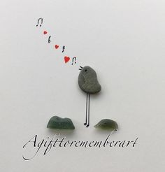 Pebble art....bird making music