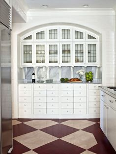 classic kitchen with built in buffet with leaded glass upper cabinets and marble backsplash