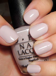 wedding nails OPI Steady As She Rose, another pale and muted hue from the Pirates of the Caribbean: On Stranger Tides collection. I would clumsily describe this as a light, grayed, rose-lavender creme