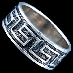 Silver ring, ring Silver ring, Ag 925/1000 - sterling silver. Gently blackened ring with Greek design. Ring width approx. 7.5mm, thickness approx. 1mm.