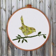 This geometric bird cross stitch pattern has beautiful colors of summer