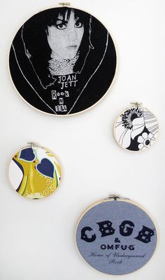 Old t-shirts & fabric scraps displayed on the wall in  wooden embroidery hoops.