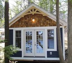 Apparently this is called a bunkie- it& a sleeping cottage to be used in the months where your windows are open- i& pretty sure it& now allowed by my property management company, but a girl can dream! Think: lake house. Casas Trailer, Small Lake Houses, Small Cabins, Tiny Houses, Plan Chalet, Prefab Cabins, Lake Cottage, Backyard Cottage, Cabins And Cottages