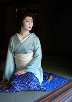Beautiful, graceful, delicate blues reflect the qualities of the woman in this picture. Geisha