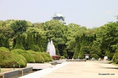Osaka Castle Park with fountain and Castle