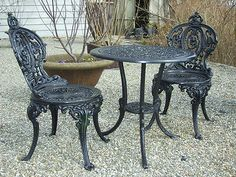 Beautiful patio table and chairs! It says they're wrought iron but I think they're actually cast iron. I think they're a Victorian style
